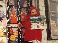 Maud Lewis in the entrance to her painted home